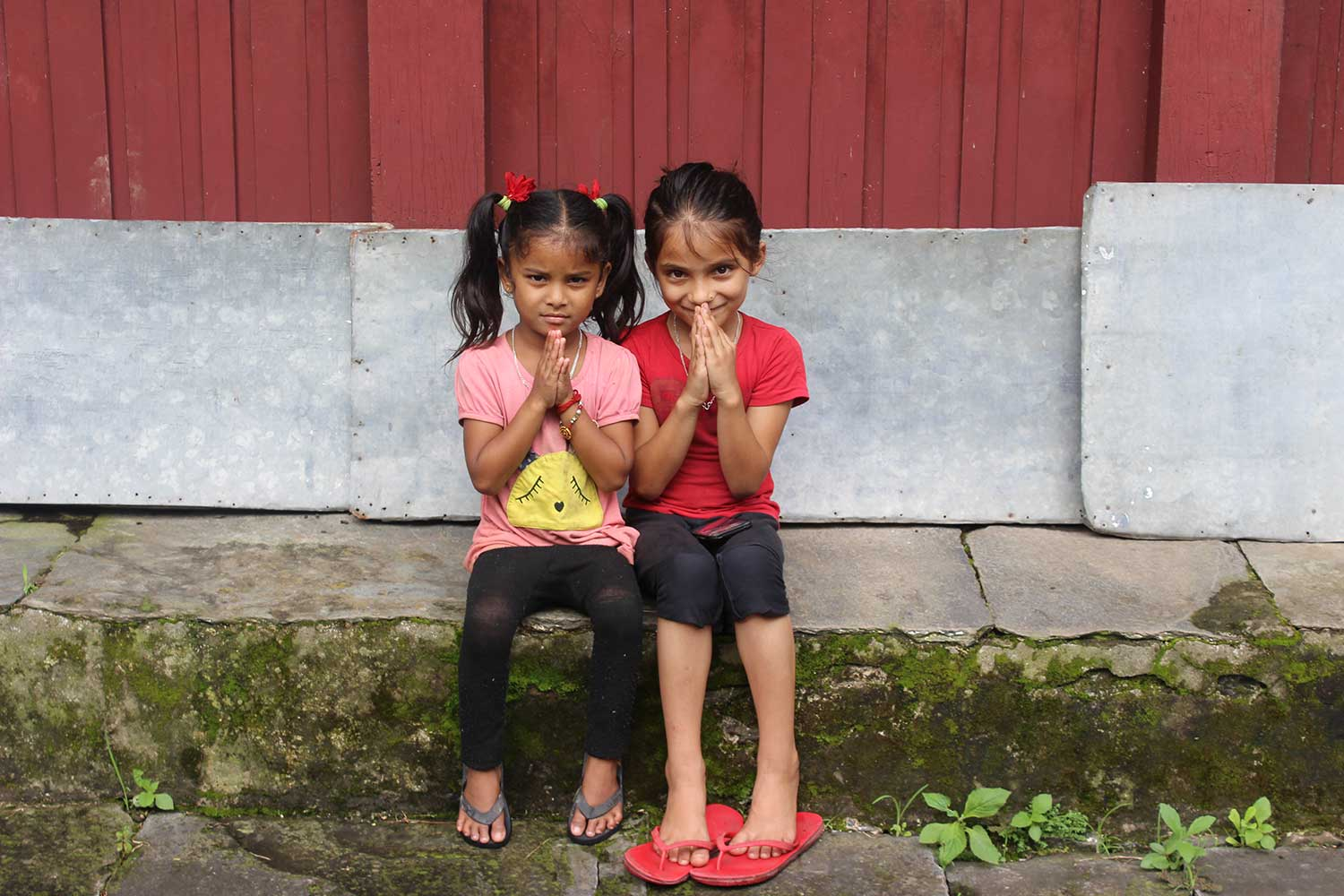 Why Hire a Guide in Nepal? Two village girls greeting.